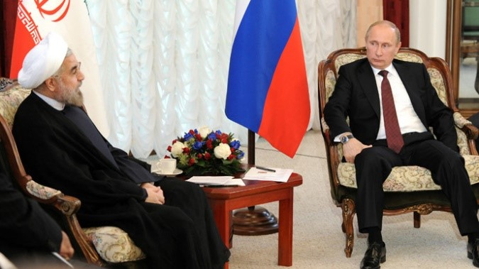 Russian President Vladimir Putin and President of the Islamic Republic of Iran Hassan Rouhani meet during the 2013 SCO summit in Bishkek. (RIA Novosti/Michael Klimentyev)